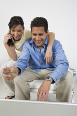 Couple Placing Order on Cell Phone
