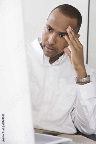 Worried Man Using a Computer
