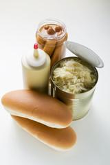 bread rolls, sauerkraut in tin, mustard, frankfurters in jar