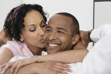 Woman Kissing Smiling Man