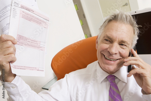 Businessman Holding Tax Forms