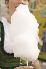 woman eating candyfloss (oktoberfest, munich)