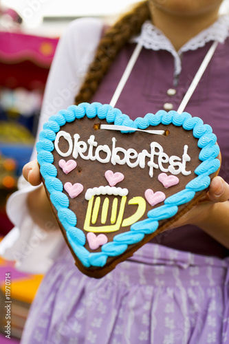 woman with lebkuchen heart (oktoberfest, munich)