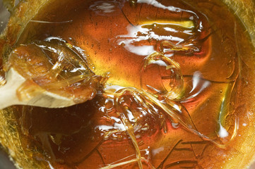 liquid caramel with wooden spoon (close-up)