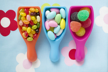 assorted coloured sweets in plastic scoops