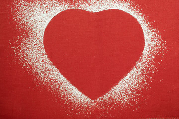 red heart shape outlined in icing sugar