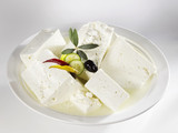 several pieces of feta cheese in brine