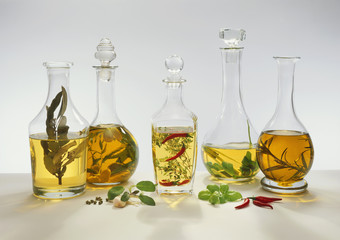 five different flavoured vinegars