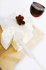 camembert with grapes and a glass of red wine