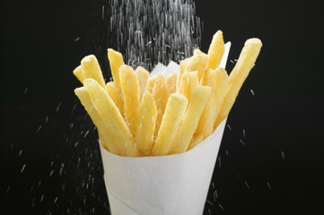 sprinkling salt over chips