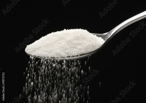 sprinkling sugar from a tablespoon