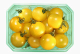 yellow cherry tomatoes in a plastic punnet