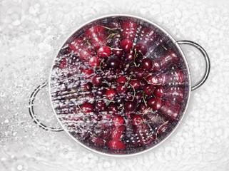 fresh cherries in a colander