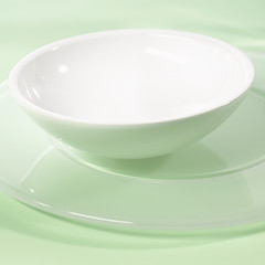 small white bowl on a service plate