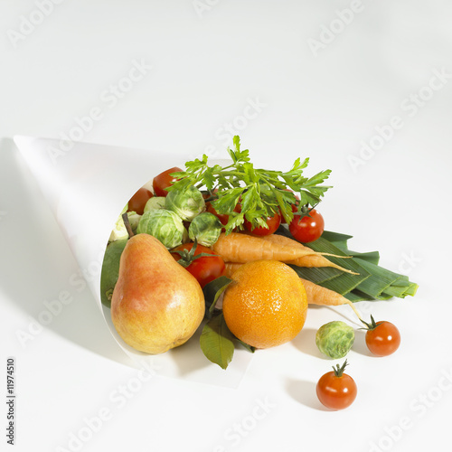 various types of fruit and vegetables in paper bag