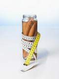 frankfurters in a jar with a tape measure wrapped around it