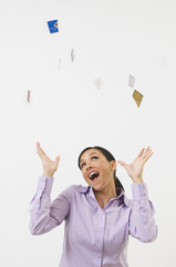 Woman Tossing Credit Cards in the Air