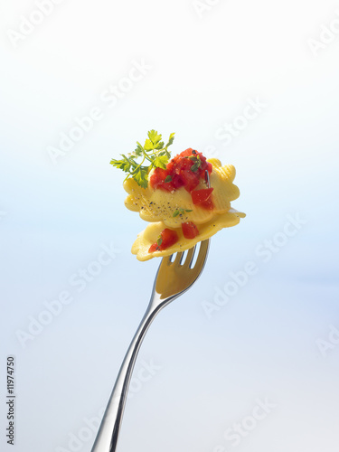 two agnolotti (filled pasta) on a fork