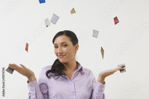 Woman Throwing away Credit Cards