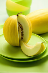 honeydew melon with a slice removed