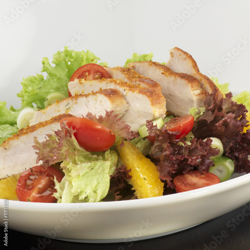 plate of salad with sliced turkey