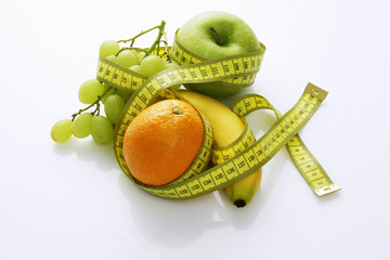 assorted fruit with a tape measure