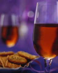 two glasses of sherry and nibbles