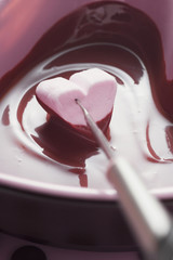 chocolate fondue with heart-shaped marshmallow