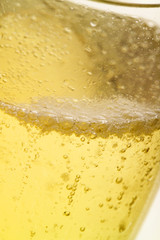 a glass of champagne with condensation (close-up)