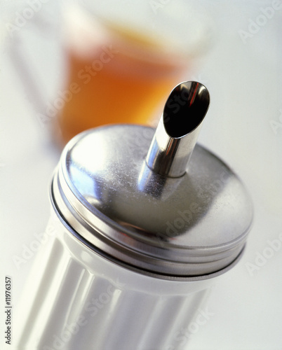sugar shaker and tea glass in background