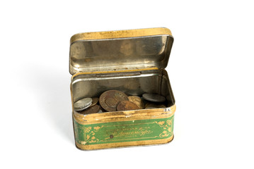 Metal rusty box with coins