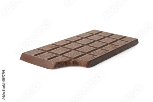 Bitten dark chocolate bar isolated on white background