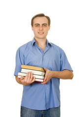 Young handsome guy with books. Isolated on white.