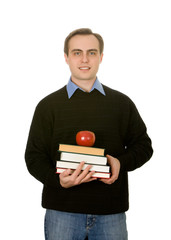 Young handsome guy holfing books and an apple. Isolated on white