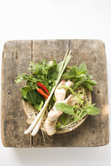 fresh thai herbs and spices in basket