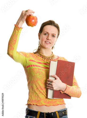 Beautiful college girl with a book and an apple. Isolated on whi