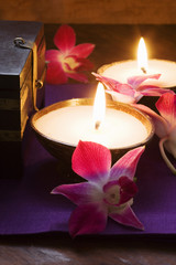 thai table decoration: candles and orchids