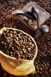 coffee beans in sack and in old coffee mill