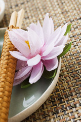 place setting with water lily and chopsticks (asia)
