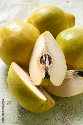 four quinces, one cut into pieces