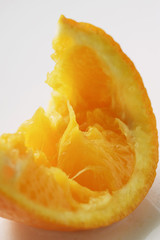 squeezed wedge of orange