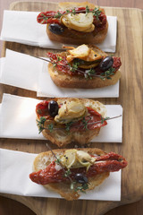 crostini with seafood and dried tomatoes