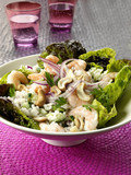 rice salad with shrimps, onions and cashew nuts