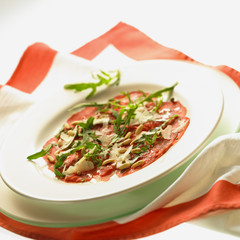 carpaccio with rocket, pine nuts and parmesan