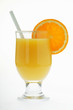orange juice in glass with straw and slice of orange