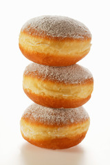 doughnuts with icing sugar, in a pile