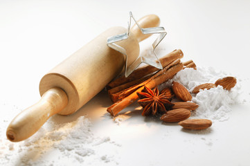 spices, almonds, icing sugar, rolling pin and cutter