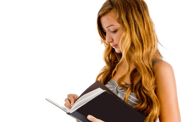 student writing in notebook