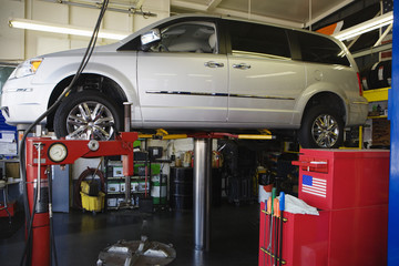 Minivan on a Lift in Shop