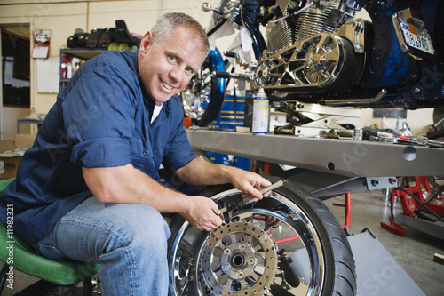 Mechanic Working on a Tire